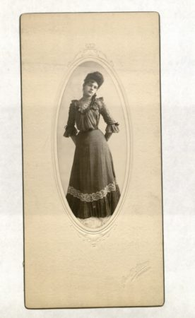 Photo of a young woman who is standing; photo by Juno B. Shane (photo courtesy Spencer Library, KU, KU-RH-PH-500:3.36)