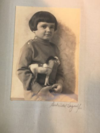 Photo of a boy and a toy horse; from Herbert Holcombe photo book by Gertrude Sayen (Photo by Gertrude Sayen, 1925 (Mcintyre-Culy collection)