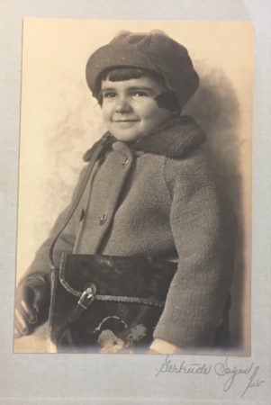 Smiling boy in coat with satchel. Photo by Gertrude Sayen, 1925 (Courtesy Mcintyre-Culy collection)